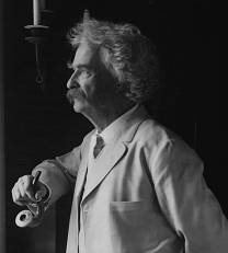 Mark_Twain_1907_looiking_out_window